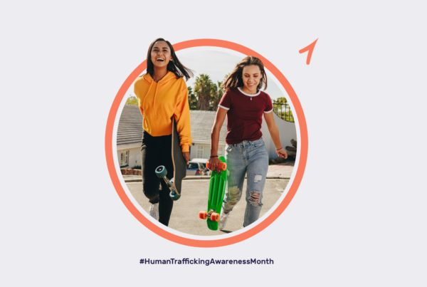 Two young girls with skateboards surrounded by Thorn branding.