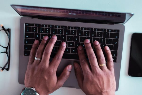Close up of hands working on a computer