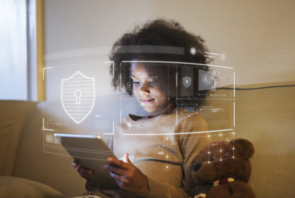 Girl holding a tablet with encrypted graphics